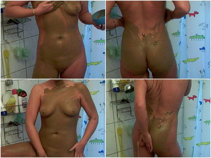 Brunette shaved pussy babe showering herself