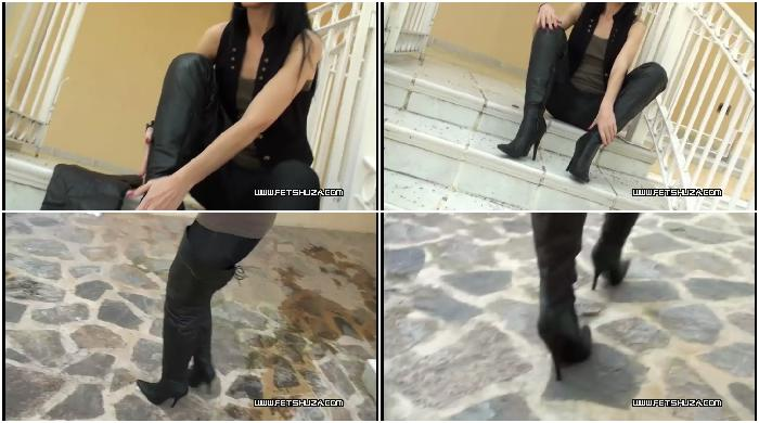 Walking in long leather boots