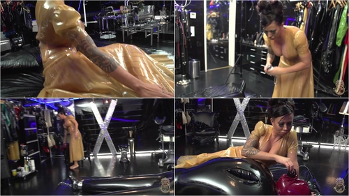 Lady kate is covered in latex and her slave in black latex 1