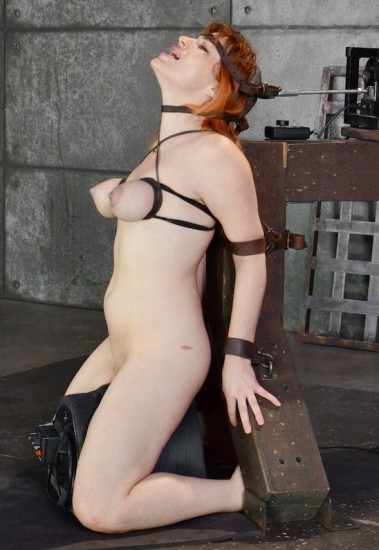 Redhead Jessica Ryan in strict bondage on sybian