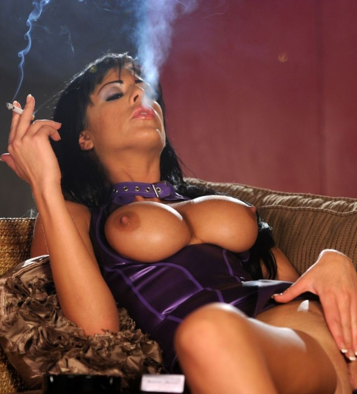 Ella Mai smokes B&H Silver wearing a stunning purple latex dress