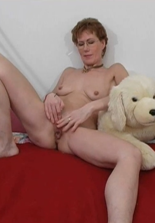 Mature close-up solo with а dildo