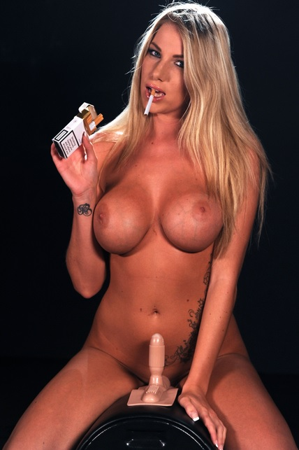 Dannii Maye rides the sybian machine smoking Rothmans corks 100s