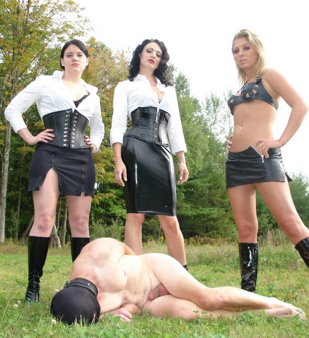 Brianna shoves the slave to her knees