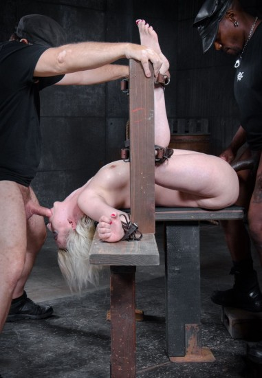 Pale skinned busty blonde Cherry Torn restrained