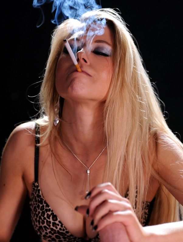Michelle Moist smokes corks 120's as she sucks your cock