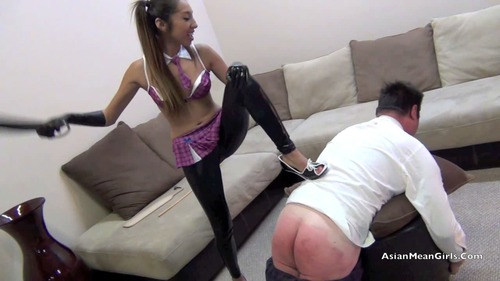 Very attractive mistress uses two slaves 3